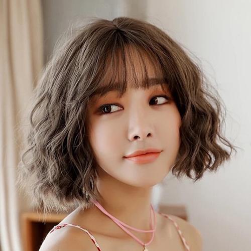 10 Kiểu tóc ngắn xoăn sóng dễ thương phù hợp mọi khuôn mặt - Ảnh 5